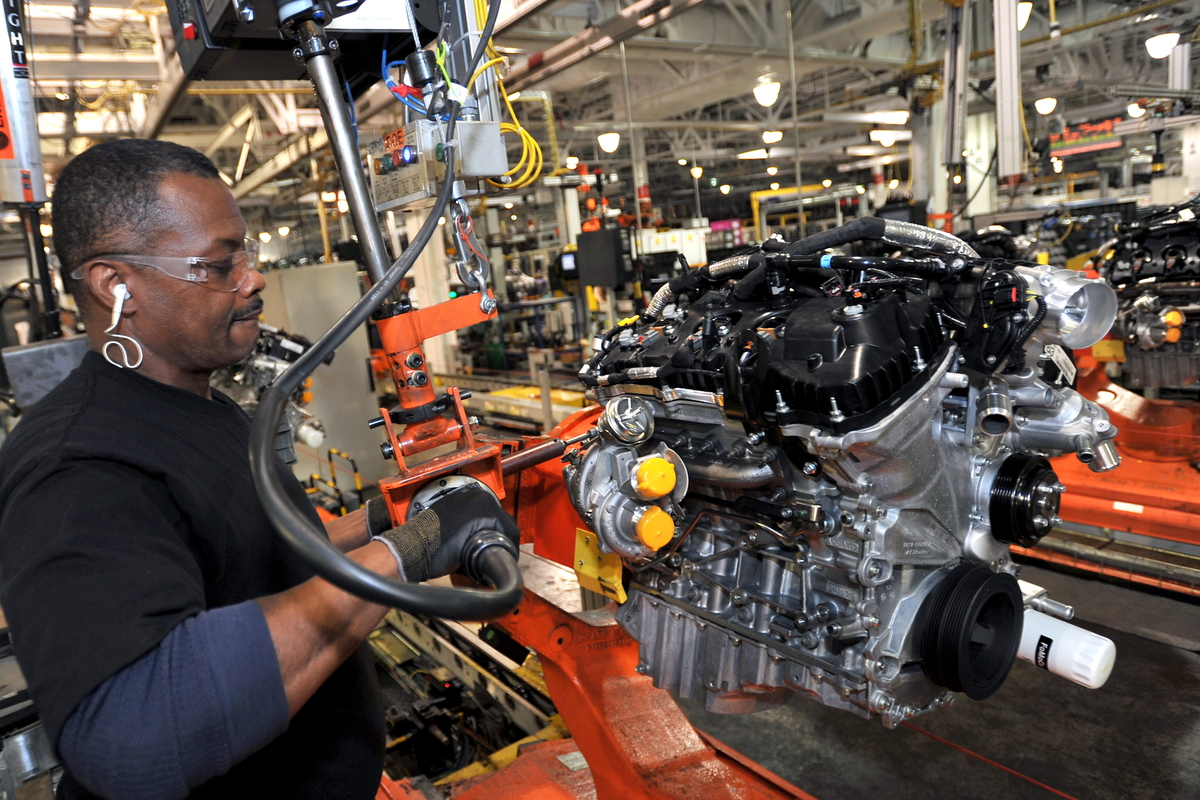Raymond Williams works on a turbocharged Ecoboost engine at  Ford's Cleveland Engine Plant.